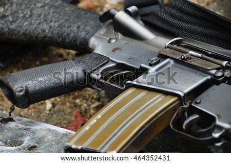 M16 rifle on rock background
