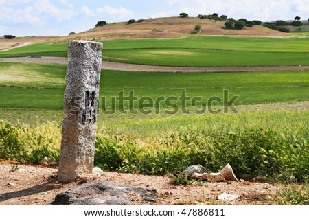 M 15 Signal Stone in a Rural Road - stock photo