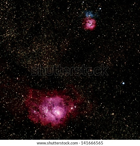 M8, The Lagoon Nebula, seen with M20, The Trifid Nebula, in the constellation Sagittarius. - stock photo