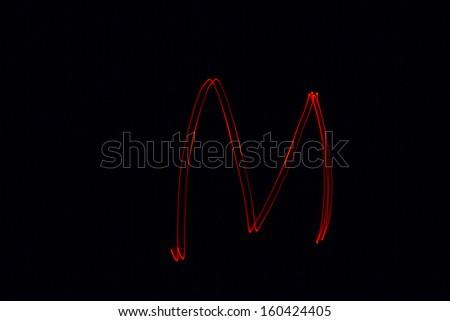 M - torch light alphabet letters - stock photo