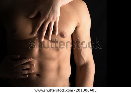 Ma's torso with woman's hands around isolated in black
