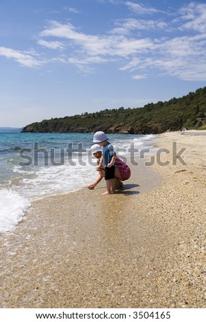Ma with child on beach