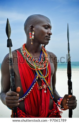 Maasai by the ocean on the beach - stock photo
