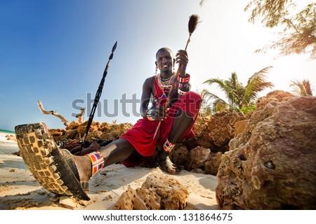 Maasai by the ocean on the beach. Kenya - stock photo