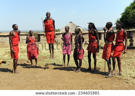 MAASAI MARA, KENYA - AUGUST 12: Maasai men in traditional clothing August 12, 2010 at Masaai Mara, Kenya. The Maasai are the most famous tribe in Africa. They are nomadic and live in small villages. - stock photo