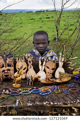 MAASAI MARA, KENYA-DECEMBER 27: Unidentified child sells traditional souvenirs 27 December, 2012 at Maasai Mara, Kenya. The Maasai are the most famous tribe in Africa. - stock photo