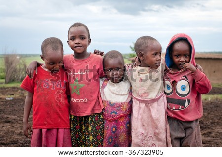 MAASAI MARA, KENYA-DECEMBER 27, 2012: Unidentified children   at Maasai Mara, Kenya. The Maasai are the most famous tribe in Africa.