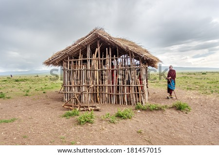 Maasai stand near Primary school for maasai children in a maasai village  in NGORONGORO  Conservative Area - stock photo