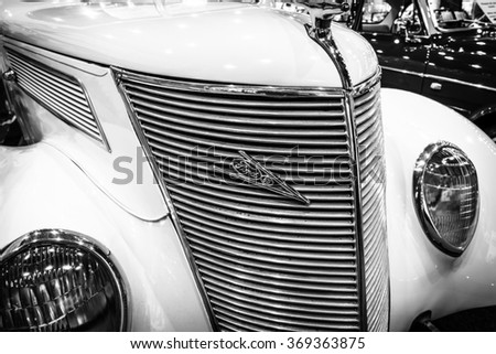 MAASTRICHT, NETHERLANDS - JANUARY 14, 2016: Full-size car Ford V8 convertible, 1937. Black and white. International Exhibition InterClassics & Topmobiel 2016 - stock photo