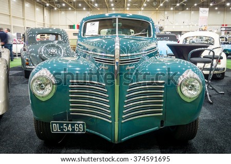 MAASTRICHT, NETHERLANDS - JANUARY 15, 2016: Full-size car Plymouth Deluxe (P10) Business Coupe, 1941. International Exhibition InterClassics & Topmobiel 2016 - stock photo