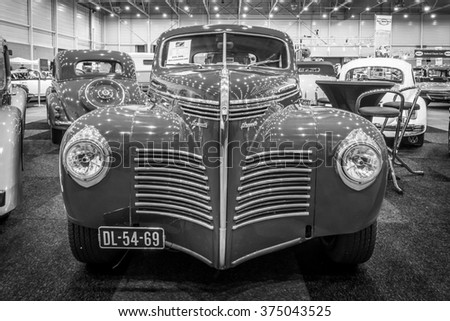MAASTRICHT, NETHERLANDS - JANUARY 15, 2016: Full-size car Plymouth Deluxe (P10) Business Coupe, 1941. Black and white.  International Exhibition InterClassics & Topmobiel 2016 - stock photo