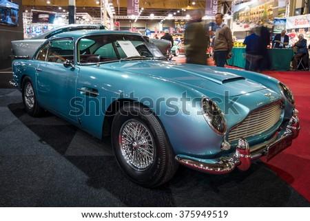 MAASTRICHT, NETHERLANDS - JANUARY 15, 2016: Grand tourer coupe Aston Martin DB5, 1964. International Exhibition InterClassics & Topmobiel 2016 - stock photo