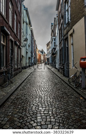 MAASTRICHT, NETHERLANDS - JANUARY 16, 2016: Old streets in the historic center. Stylization. Toning.  Maastricht is the oldest city of the Netherlands and the capital city of the province of Limburg.