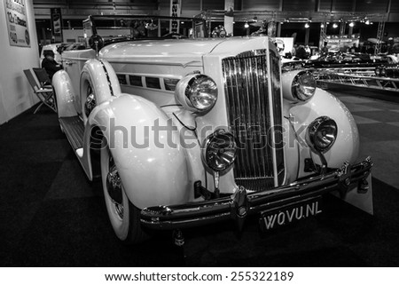 MAASTRICHT, NETHERLANDS - JANUARY 08, 2015: Oldtimer Packard 120 Convertible Sedan with Dietrich Body, 1937. Black and white. International Exhibition InterClassics & Topmobiel 2015 - stock photo