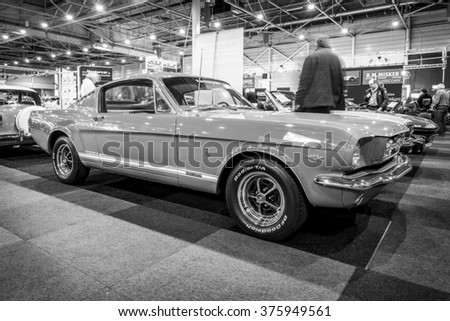 MAASTRICHT, NETHERLANDS - JANUARY 15, 2016: Pony car Ford Mustang GT (first generation), 1965. Black and white. International Exhibition InterClassics & Topmobiel 2016