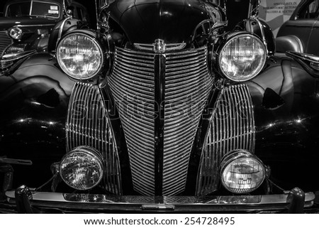 MAASTRICHT, NETHERLANDS - JANUARY 08, 2015: Radiator grill and headlamps of a car Cadillac Series 75 Imperial Sedan, 1939. Black and white. International Exhibition InterClassics & Topmobiel 2015 - stock photo