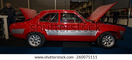 MAASTRICHT, NETHERLANDS - JANUARY 09, 2015: Small family car Ford Escort RS1600. Side view. International Exhibition InterClassics & Topmobiel 2015 - stock photo