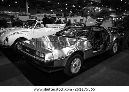 MAASTRICHT, NETHERLANDS - JANUARY 09, 2015: Sports car DeLorean DMC-12. Black and white. International Exhibition InterClassics & Topmobiel 2015 - stock photo