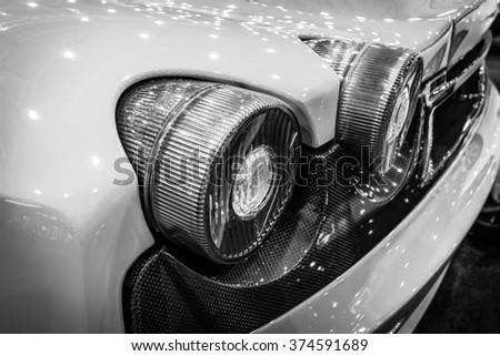 MAASTRICHT, NETHERLANDS - JANUARY 15, 2016: Stoplight of a sports car Ferrari F430, close-up, 2006. Black and white. International Exhibition InterClassics & Topmobiel 2016 - stock photo