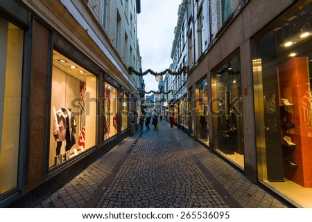MAASTRICHT, NETHERLANDS - JANUARY 09, 2015: The narrow shopping streets in the historic center. Maastricht is the oldest city of the Netherlands and the capital city of the province of Limburg.
