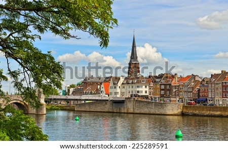 MAASTRICHT, NETHERLANDS-JULY 07, 2014: Panorama of Maastricht from river Maas or Meuse. The city is a capital of Limburg province and one of popular tourist destinations - stock photo