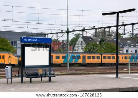 Maastricht railway station, Inter city train on the platform, Netherlands - stock photo