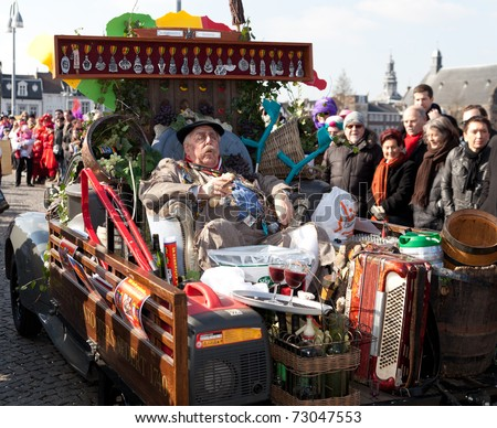 MAASTRICHT, THE NETHERLANDS - MARCH 6: Unidentified man in the Carnival parade dressed as a French farmer on March 6, 2011 in Maastricht, The Netherlands. This parade is organized yearly with about 100,000 visitors. - stock photo