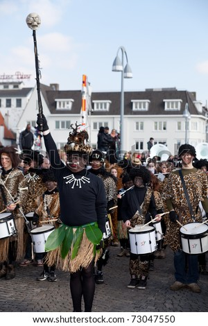 MAASTRICHT, THE NETHERLANDS - MARCH 6: Unidentified men in the Carnival parade dressed as bush men on March 6, 2011 in Maastricht, The Netherlands. This parade is organized every year with about 100,000 visitors. - stock photo