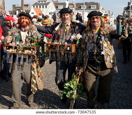 MAASTRICHT, THE NETHERLANDS - MARCH 6: Unidentified men in the Carnival parade dressed as French farmers on March 6, 2011 in Maastricht, The Netherlands. This parade is organized yearly with about 100,000 visitors. - stock photo