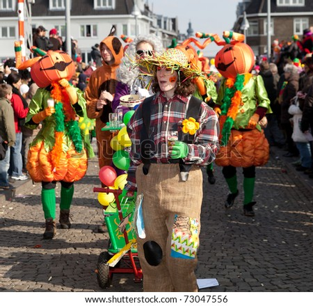 MAASTRICHT, THE NETHERLANDS - MARCH 6: Unidentified people in a Carnival parade dressed as pumpkins and scarecrow on March 6, 2011 in Maastricht, The Netherlands. This parade is organized yearly with 100,000 visitors - stock photo