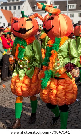 MAASTRICHT, THE NETHERLANDS - MARCH 6: Unidentified people in the Carnival parade dressed as pumpkins on March 6, 2011 in Maastricht, The Netherlands. This parade is organized every year with about 100,000 visitors.