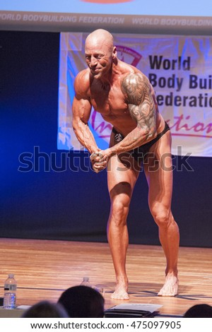 MAASTRICHT, THE NETHERLANDS - OCTOBER 25, 2015: Male bodybuilder Erik Stobbe flexes his muscles and shows his physique in a most muscular pose on stage at the World Grandprix Bodybuilding and Fitness