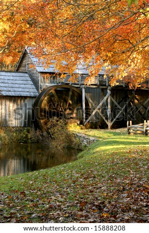 Mabry Mill, Meadows of Dan, Virginia in Autumn Vertical With Spinning Waterwheel - stock photo