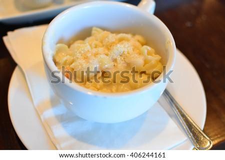 mac n cheese in mug - stock photo