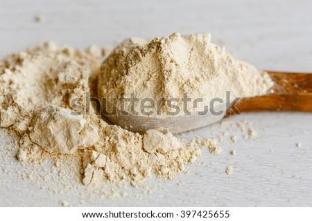 Maca powder on wooden spoon - stock photo