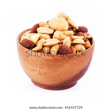 Macadamia nuts, cashews, almonds, peanuts on white background - stock photo