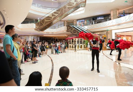 Macao, China - June 25, 2015:tourists watching the dancing performers in a hotels in New Sands Macao, Macao on June 25, 2015.