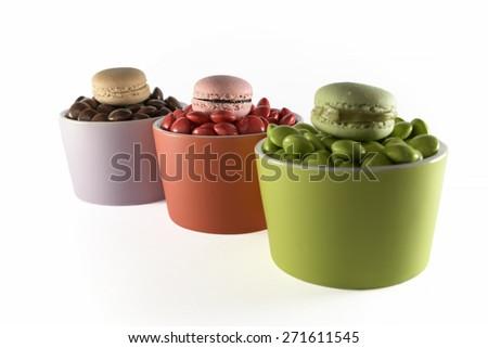 macaron candy chocolate bowl on white background - stock photo