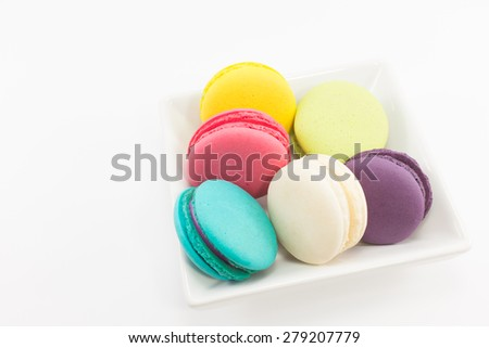 Macaron in plate on white background.
