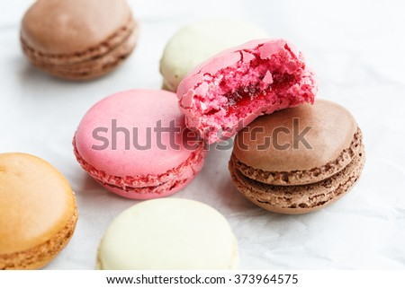 Macaron (small French cake), one partly eaten - stock photo