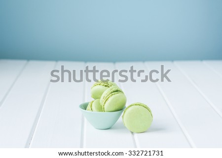 macaron sweet biscuit, green and blue colours - stock photo