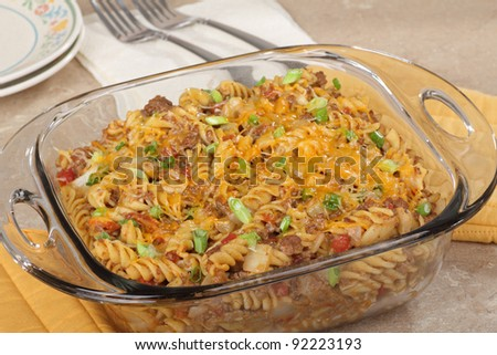 Macaroni and cheese casserole in a glass baking dish - stock photo