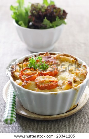macaroni and cheese with cherry tomato on top
