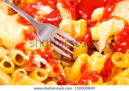 Macaroni and cheese with ketchup - stock photo