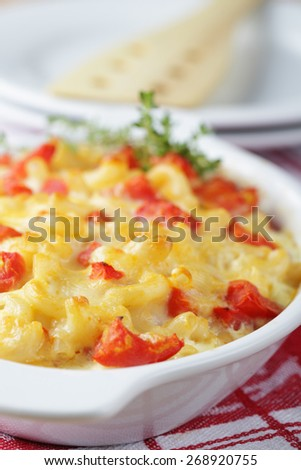 Macaroni and cheese with tomato in a baking dish. Selective focus - stock photo