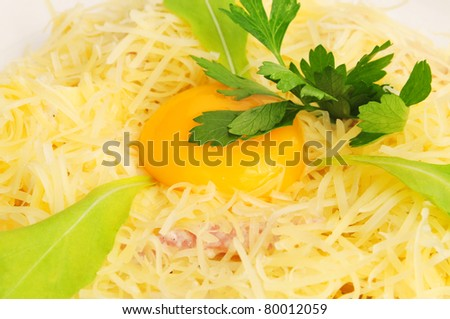 Macaroni baked with fish on a white plate - stock photo