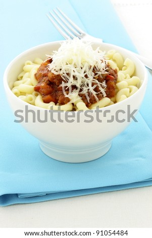 Macaroni Bolognese delicious meal made with beef, pork, lots of vegetables and tons of flavor. This family favorite is always a welcomed addition for lunch or at dinnertime and kids will love it. - stock photo