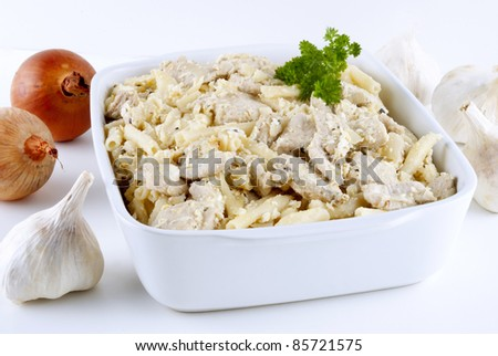 Macaroni casserole with chicken goulash and garlic sauce - stock photo