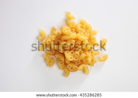 Macaroni dry pasta on white background - stock photo