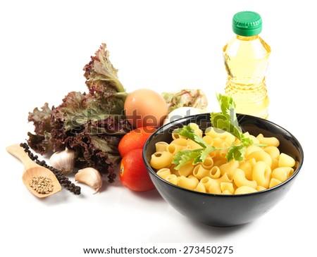 macaroni pasta spaghetti, vegetables and spices, isolated on white - stock photo
